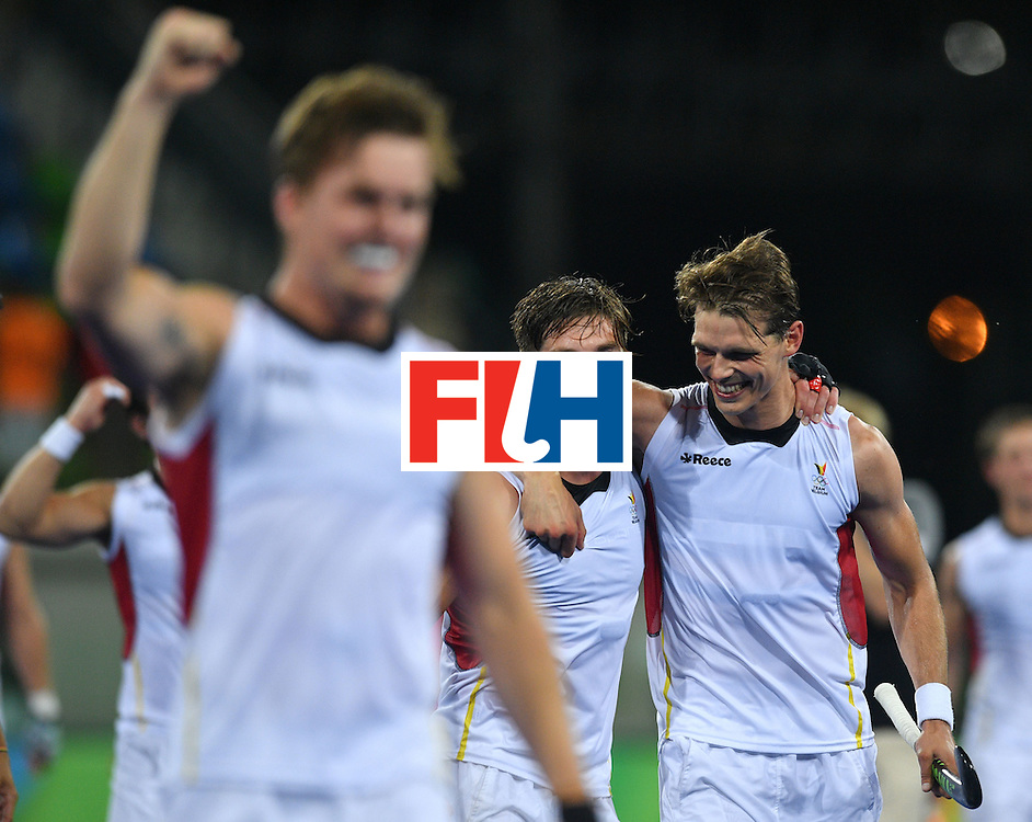 Belgium's Tom Boon (R) and Belgium's Cedric Charlier celebrate winning the men's semifinal field hockey Belgium vs Netherlands match of the Rio 2016 Olympics Games at the Olympic Hockey Centre in Rio de Janeiro on August 16, 2016.  / AFP / Carl DE SOUZA        (Photo credit should read CARL DE SOUZA/AFP/Getty Images)