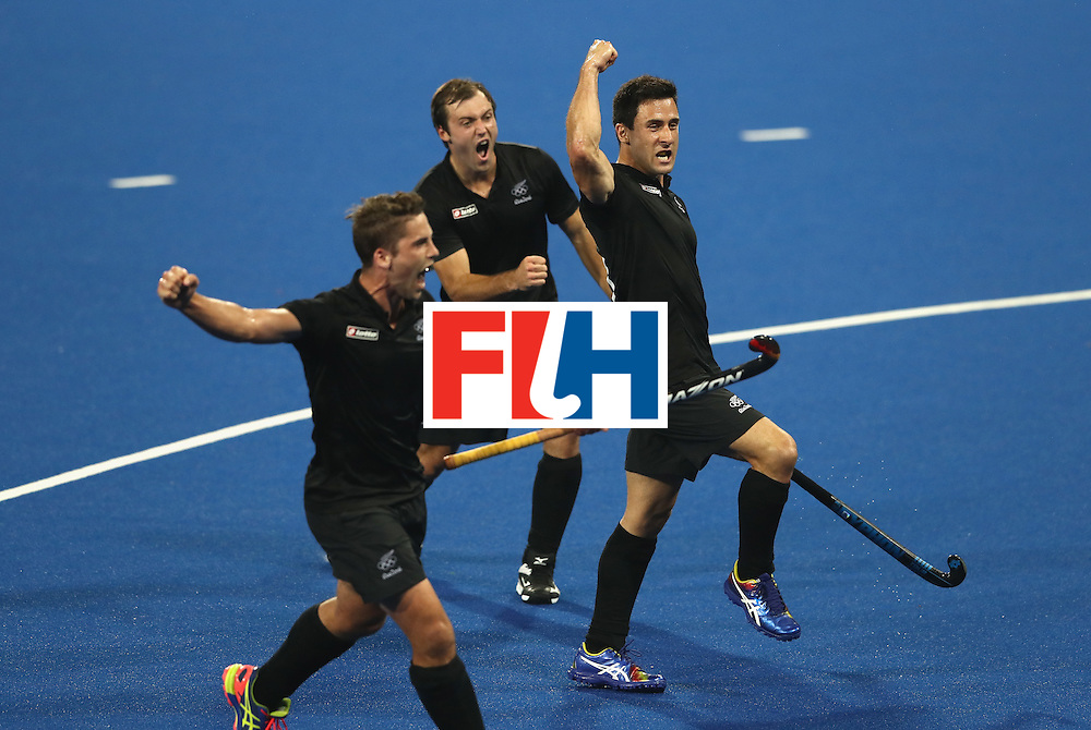 RIO DE JANEIRO, BRAZIL - AUGUST 14:  New Zealand celebrate after Shea McAlesse scores their second goal during the Men's hockey quarter final match between the Germany and New Zealand on Day 9 of the Rio 2016 Olympic Games at the Olympic Hockey Centre on August 14, 2016 in Rio de Janeiro, Brazil.  (Photo by David Rogers/Getty Images)