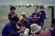 Mongolia. Ulaanbaatar. Family drinking koumis   /  Un repas de famille devant la yourte, Cavaliers de la steppe la sortie de Oulan bator