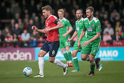 Simon Heslop (Captain) (York City) runs with the ball, chased by Jordan White (Wrexham AFC) during the Vanarama National League match between York City and Wrexham FC at Bootham Crescent, York, England on 17 April 2017. Photo by Mark P Doherty.
