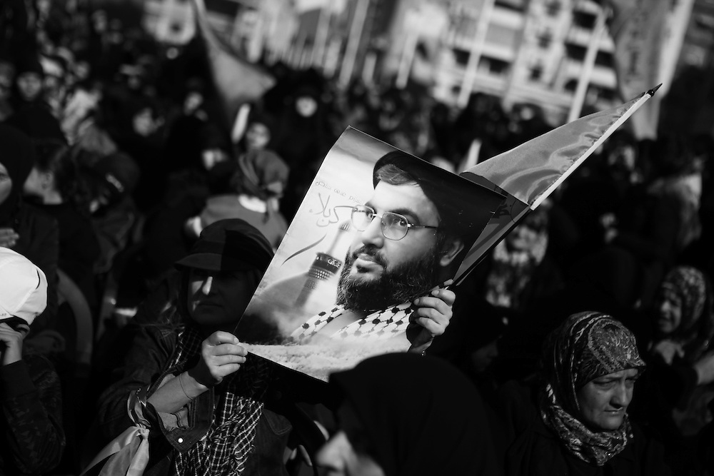 Many in the crowd carried pictures of Hezbollah party leader Hassan Nasrallah - but few realized he would be attending.