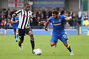 AFC Wimbledon striker Andy Barcham (17) battles for possession with Rochdale defender Donervon Daniels (29)  during the EFL Sky Bet League 1 match between AFC Wimbledon and Rochdale at the Cherry Red Records Stadium, Kingston, England on 30 September 2017. Photo by Matthew Redman.