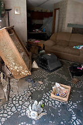 03 November, 2005. New Orleans, Louisiana. Post Katrina. <br /> Inside a flood ravaged mouldy trailer. The remains of debris strewn Oak Grove trailer park in Saint Bernard parish just south of New Orleans. Hurricane Katrina caused a 20ft tidal surge to sweep over the land, devastating much of the parish.<br /> Photo; ©Charlie Varley/varleypix.com