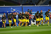 Burton Albion players enter the stadium for the warm up during the EFL Sky Bet Championship match between Queens Park Rangers and Burton Albion at the Loftus Road Stadium, London, England on 23 September 2017. Photo by John Potts.