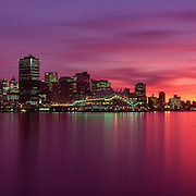 Canada, British Columbia, Vancouver skyline and Coal Harbour at sunset