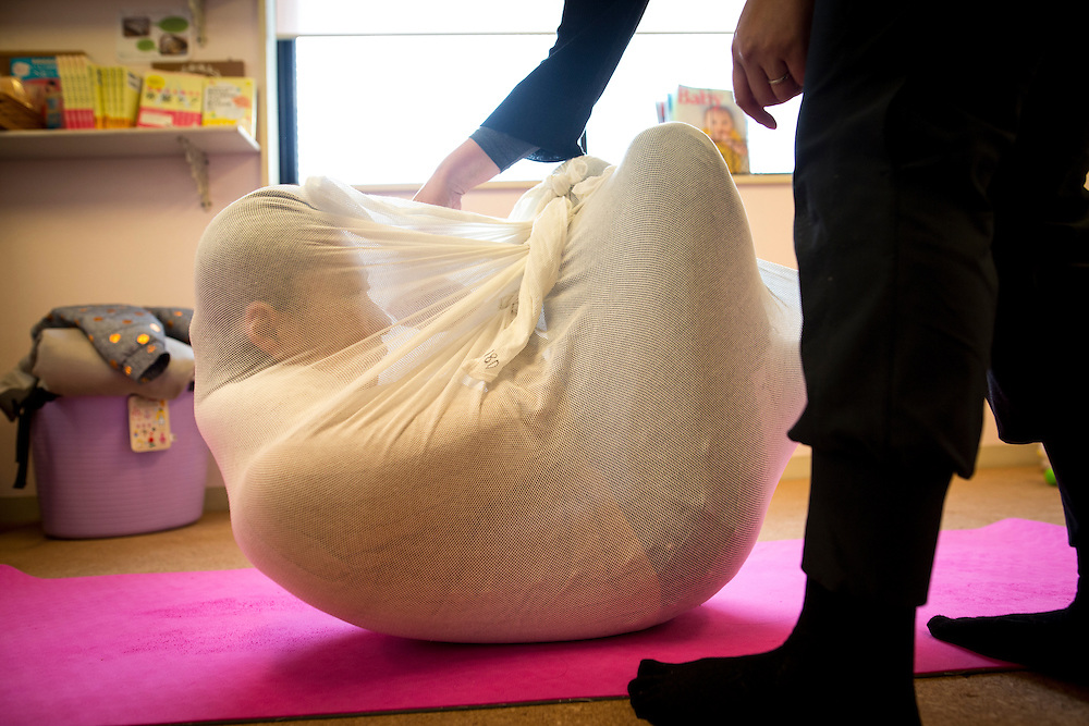 "TOKYO, JAPAN - JANUARY 29 : A woman wrapped during a workshop called ""Otonamaki"", which directly translates to adult wrapping in Tokyo, Japan on Sunday, January 29, 2017. Otonamaki is a Japanese therapeutic method meant to alleviate posture problems and stiffness. (Photo by Richard Atrero de Guzman/ANADOLU Agency)"