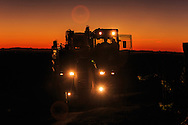 Pellenc mechanical harvester at sunset on the first night of harvest in a Paso Robles vineyard.