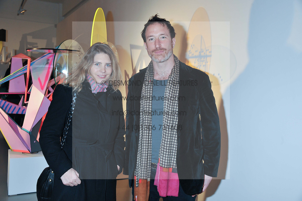Director of the Saatchi Gallery PHILLY ADAMS and artist PETROC SESTI at a private view of Tobias Rehberger's latest work entitled 'Sex and Friends' held at the Pilar Corrias Gallery, 54 Eastcastle Street, London W1 on 12th January 2012.