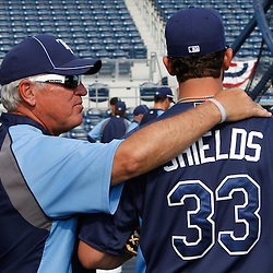 March 15, 2011; Port Charlotte, FL, USA; Tampa Bay Rays manager Joe Maddon (70) and starting pitcher James Shields (33) talk before a spring training exhibition game against the Florida Marlins at Charlotte Sports Park.   Mandatory Credit: Derick E. Hingle