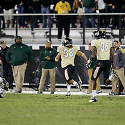 UCF Knights defensive back Jordan Ozerities (38) runs back an interception late in the game during an NCAA football game between the South Florida Bulls and the 17th ranked University of Central Florida Knights at Bright House Networks Stadium on Friday, November 29, 2013 in Orlando, Florida. (AP Photo/Alex Menendez)