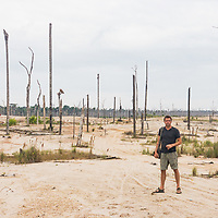 iPhone self-portrait of photographer, Jason Houston. Following the February 2019 crackdown in illegal and unofficial alluvial gold mining in the La Pampa region of Madre de Dios, Wake Forest University's Puerto Maldonado-based Centro de Innovación Científica Amazonia (CINCIA), a leading research institution for the development of technological innovation for biological conservation and environmental restoration in the Peruvian Amazon, is applying years of scientific research and technical experience related to understanding mercury contamination and managing Amazonian ecosystems to help guide urgent remediation, restoration, and reforestation efforts that can also serve as models for how we address the tropic's most dramatically devastated landscapes around the world. La Pampa, Madre de Dios, Peru.