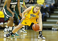 January 27 2010: Iowa forward Kelly Krei (20) picks up a lose ball during the second half of an NCAA women's college basketball game at Carver-Hawkeye Arena in Iowa City, Iowa on January 27, 2010. Iowa defeated Michigan State 66-64.