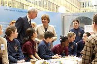 """03 FEB 2004, BERLIN/GERMANY:<br /> Angela Merkel, CDU Bundesvorsitzende, mit Kindern, die am Workshop für Kids """"Elektrizitaet-Magnetismus-Bewegung"""" teilnehmen, Auftaktkongress zum IHK-Jahresthema """"Innovation Unternehmen!"""", Links: Ludwig Georg Braun, Praesident DIHK, Deutscher Industrie- und Handelskammertag, Haus der Deutschen Wirtschaft <br /> IMAGE: 20040203-01-046<br /> KEYWORDS: Innovationskongress"""
