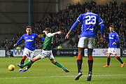 Emerson Hyndman stretches to block Alfredo Morelos during the Ladbrokes Scottish Premiership match between Hibernian and Rangers at Easter Road, Edinburgh, Scotland on 19 December 2018.