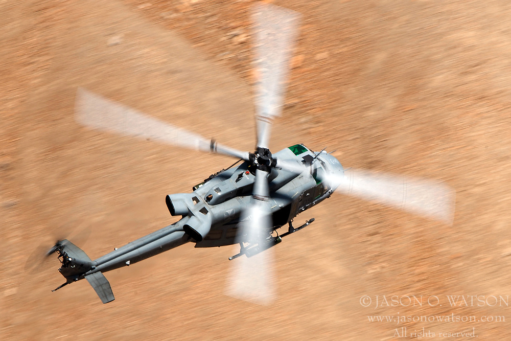United States Marines Corps Bell UH-1Y Venom (SN 168797) flies low level on the Jedi Transition through Star Wars Canyon / Rainbow Canyon, Death Valley National Park, Panamint Springs, California, United States of America