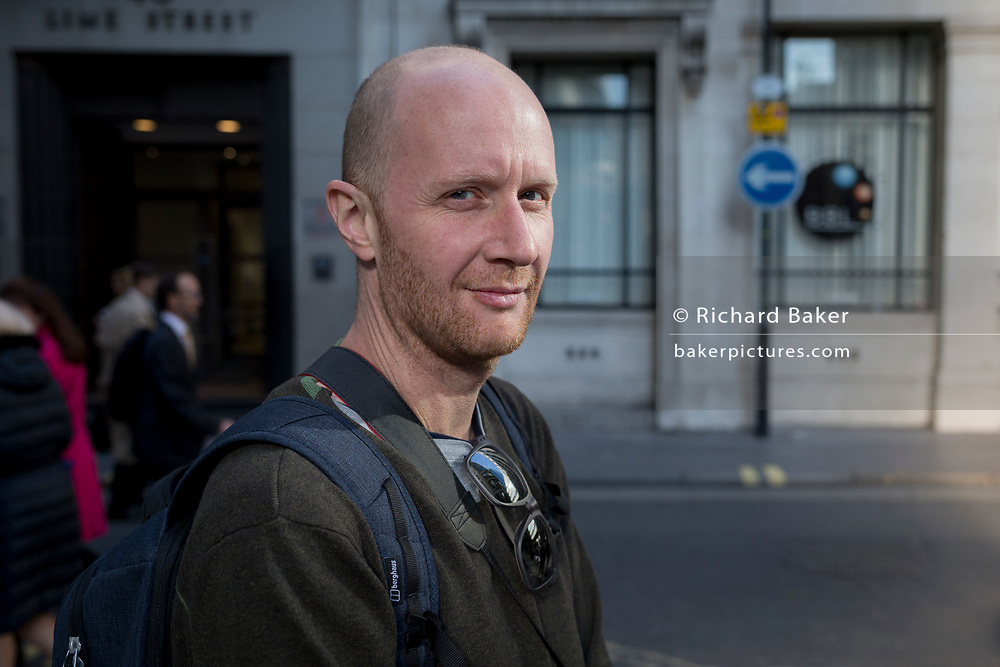The photographer Mike Kemp in Lime Street, on 10th May 2017, in the City of London, England.
