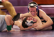 Cornell's Tigue Snider (top) pins Simpson's Austin Glick in the 133 lb weight class match between Simpson College and Cornell College at the Small Multi-Sport Center in Mount Vernon on Wednesday November 19, 2008. Cornell won the meet 35-10.