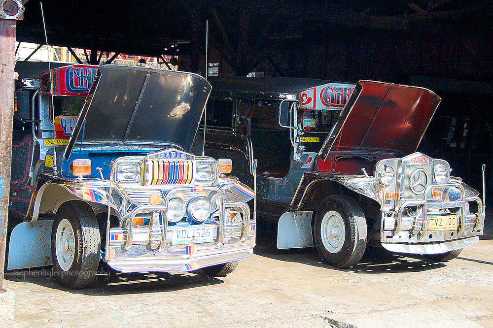 Jeepneys waiting to be worked on in the old Sarao Motors Jeepney plant in Las Pinas. Though this plant no longer builds these vehicles, it remains open for minor repairs and for public tours. Jeepneys are the most popular means of public transportation in the Philippines, originally made from US military jeeps left over from World War II. They are well known for their flamboyant decorations and crowded seating, and are one of the symbols of Philippine culture.