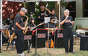 "Vocalist Henry ""Shig"" Sakamoto (right) performs with The Minidoka Swing Band on the grounds of Washington Country Museum, Hillsboro, Oregon"