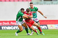 Dan Jones of Scarlets is tackled by Nicola Quaglio of Benetton Treviso<br /> <br /> Photographer Craig Thomas/Replay Images<br /> <br /> Guinness PRO14 Round 3 - Scarlets v Benetton Treviso - Saturday 15th September 2018 - Parc Y Scarlets - Llanelli<br /> <br /> World Copyright &copy; Replay Images . All rights reserved. info@replayimages.co.uk - http://replayimages.co.uk