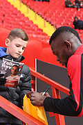 "Charlton Athletics Igor Vetokele signs and gives his ""Kick it out"" shirt to a young fan before the Sky Bet Championship match between Charlton Athletic and Ipswich Town at The Valley, London, England on 29 November 2014."
