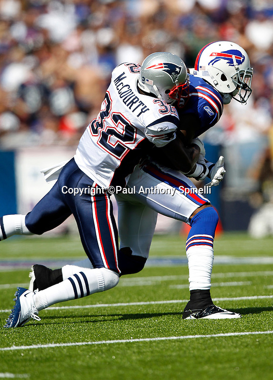 Buffalo Bills wide receiver Steve Johnson (13) gets tackled by New England Patriots cornerback Devin McCourty (32) during the NFL week 3 football game against the New England Patriots on Sunday, September 25, 2011 in Orchard Park, New York. The Bills won the game 34-31. ©Paul Anthony Spinelli