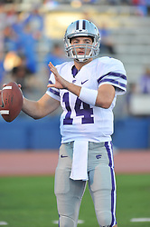 Oct 14, 2010; Lawrence, KS, USA; Kansas State Wildcats quarterback Carson Coffman (14) warms up before the game against the Kansas Jayhawks at Memorial Stadium. The Jayhawks won 59-7.  Mandatory Credit: Denny Medley-US PRESSWIRE