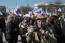 Crimea one day before the referendum. A man take some pictures  in a pro Russian rally at Simferopol's Lenin Square . Simferopol, . Saturday, 15th March 2014. Picture by Daniel Leal-Olivas / i-Images