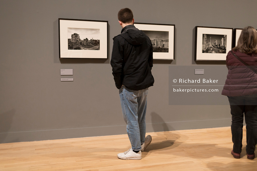 Sam Baker looks at the landscape photography of Don McCullin at Tate Britain, on 10th March 2019, in London, England.