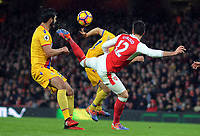 Football - 2016 / 2017 Premier League - Arsenal vs. Crystal Palace<br /> <br /> Olivier Giroud of Arsenal scores his goal with a magnificent back kick over his head as James Tomkins (left) can only watch at The Emirates.<br /> <br /> COLORSPORT/ANDREW COWIE