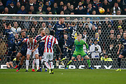 Free lick from Stoke City midfielder Oghenekaro Etebo (8) saved by Leeds United goalkeeper Bailey Peacock-Farrell (1)  during the EFL Sky Bet Championship match between Stoke City and Leeds United at the Bet365 Stadium, Stoke-on-Trent, England on 19 January 2019.