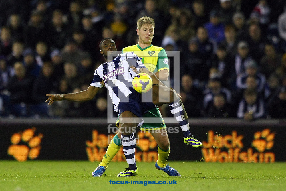 Picture by Paul Chesterton/Focus Images Ltd +44 7904 640267<br /> 07/12/2013<br /> Michael Turner of Norwich and Victor Anichebe of West Brom in action during the Barclays Premier League match at The Hawthorns, West Bromwich.