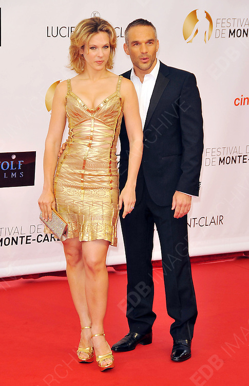 10.JUNE.2012. MONACO<br /> <br /> LORIE BAS AND PHILIPPE BAS ATTEND THE OPENING CEREMONY OF THE 52ND MONTE CARLO TELEVISION FESTIVAL HELD AT THE GRAMALDI FORUM.  <br /> <br /> BYLINE: EDBIMAGEARCHIVE.CO.UK<br /> <br /> *THIS IMAGE IS STRICTLY FOR UK NEWSPAPERS AND MAGAZINES ONLY*<br /> *FOR WORLD WIDE SALES AND WEB USE PLEASE CONTACT EDBIMAGEARCHIVE - 0208 954 5968*