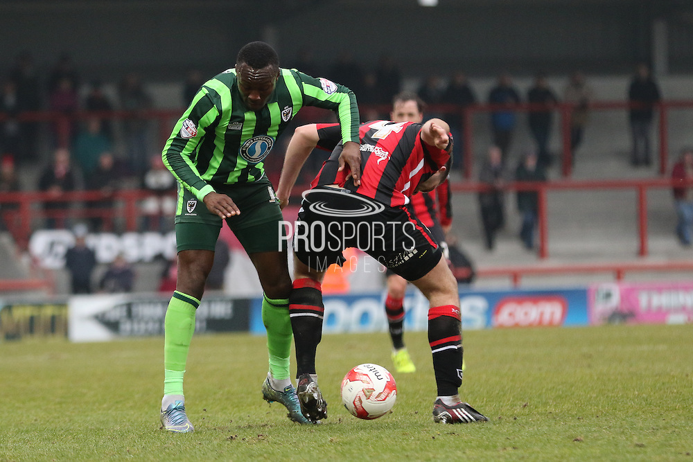 Ade Azeez of AFC Wimbledon and Alex Kenyon of Morecambe FC tussle during the Sky Bet League 2 match between Morecambe and AFC Wimbledon at the Globe Arena, Morecambe, England on 12 March 2016. Photo by Stuart Butcher.