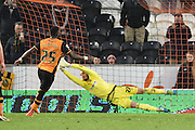 David Button (27) of Brentford save penalty taken by Hull City striker Adama Diomande (25) during the Sky Bet Championship match between Hull City and Brentford at the KC Stadium, Kingston upon Hull, England on 26 April 2016. Photo by Ian Lyall.