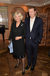 HRH The DUCHESS OF CORNWALL and her son TOM PARKER BOWLES at a party to celebrate the publication of 'Let's Eat meat' by Tom Parker Bowles held at Fortnum & Mason, Piccadilly, London on 21st October 2014.