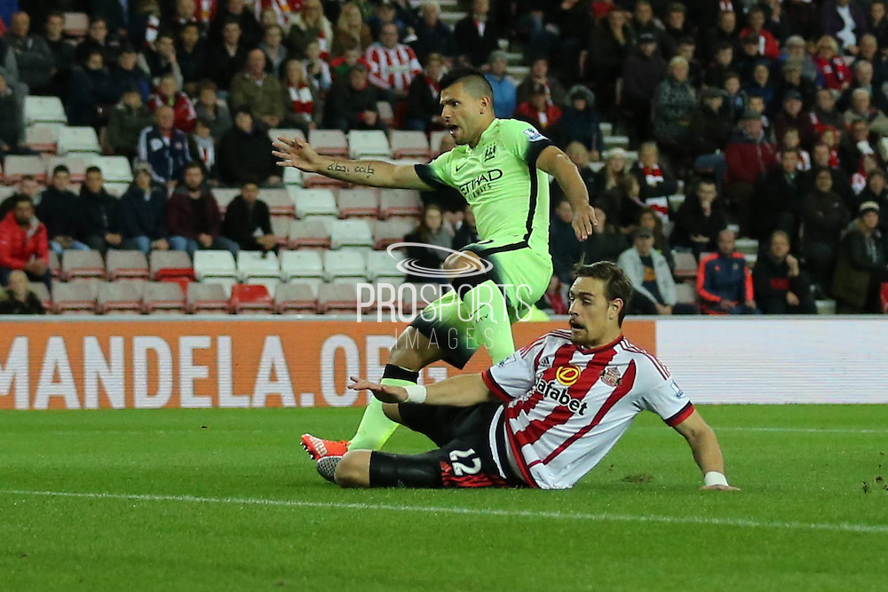 Sunderland defender Sebastian Coates stops Manchester City forward Sergio Aguero during the Capital One Cup match between Sunderland and Manchester City at the Stadium Of Light, Sunderland, England on 22 September 2015. Photo by Simon Davies.