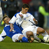 Queen of the South v St Johnstone..1.11.03<br />Ross Forsyth is tackled by David Bagan<br /><br />Picture by Graeme Hart.<br />Copyright Perthshire Picture Agency<br />Tel: 01738 623350  Mobile: 07990 594431