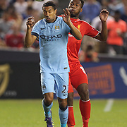 Gaël Clichy, (left), Manchester City, is challenged by Daniel Sturridge, Liverpool, during the Manchester City Vs Liverpool FC Guinness International Champions Cup match at Yankee Stadium, The Bronx, New York, USA. 30th July 2014. Photo Tim Clayton