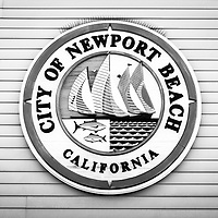 City of Newport Beach sign black and white picture. Newport Beach is an affluent beach community in Orange County Southern California.
