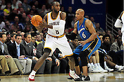 April 13, 2011; Cleveland, OH, USA; Cleveland Cavaliers guard Christian Eyenga (8) looks for a pass under pressure from Washington Wizards small forward Maurice Evans (6) during the third quarter at Quicken Loans Arena. The Cavaliers beat the Wizards 100-93. Mandatory Credit: Jason Miller-US PRESSWIRE