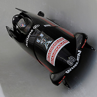 28 February 2007:   The USA 2 bobsled driven by Todd Hays with sidepushers T.J. Burns and Alex Sprague, and brakeman  Bill Schuffenhauer drive through turn 20 in the 1st run at the 4-Man World Championships competition on February 27 at the Olympic Sports Complex in Lake Placid, NY.
