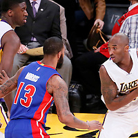 15 November 2015: Detroit Pistons forward Marcus Morris (13) defends on Los Angeles Lakers forward Kobe Bryant (24) next to Los Angeles Lakers center Roy Hibbert (17) during the Los Angeles Lakers 97-85 victory over the Detroit Pistons, at the Staples Center, Los Angeles, California, USA.