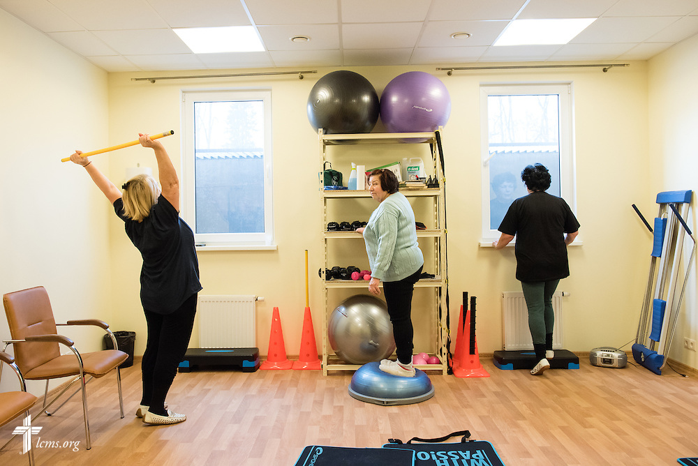 Women exercise together following Divine Service on Wednesday, Feb. 4, 2015, at a Diaconia Center mercy project site based at a municipal apartment in Riga, Latvia. LCMS Communications/Erik M. Lunsford