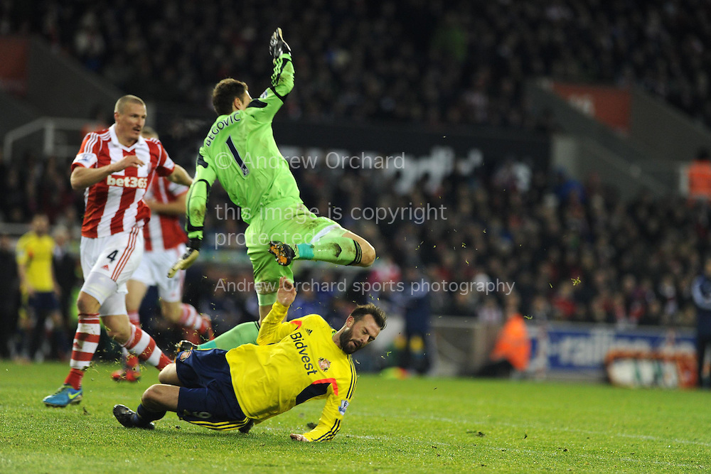 Stoke city goalkeeper Asmir Begovic fouls/collides with Sunderland's Steven Fletcher but the referee Kevin Friend doesn't award a penalty.  Barclays Premier league, Stoke city v Sunderland at the Britannia stadium in Stoke on Trent, England on Saturday 23rd Nov 2013. pic by Andrew Orchard, Andrew Orchard sports photography,