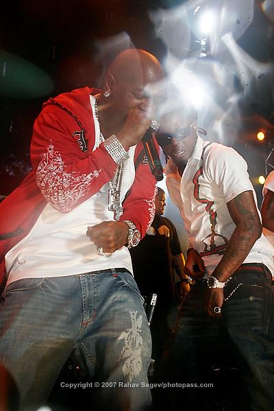 Lil' Wayne and Birdman (in red) performing at Giant's Stadium in East Rutherford New Jersey on June 3, 2007 during Hot 97's Summerjam 2007...© Rahav Segev/ Retna ltd.