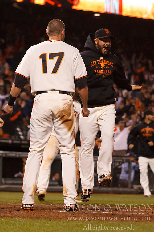 July 6, 2011; San Francisco, CA, USA;  San Francisco Giants left fielder Cody Ross (right) celebrates after right fielder Nate Schierholtz (not pictured) hit the game winning home run against the San Diego Padres during the fourteenth inning at AT&T Park. San Francisco defeated San Diego 6-5 in 14 innings.