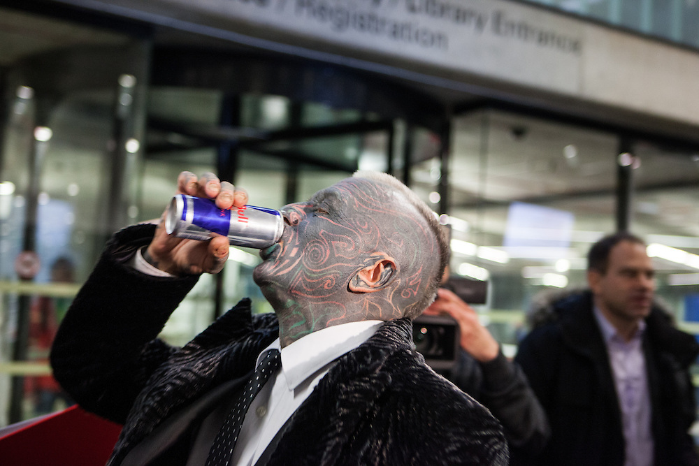 Prof. Vladimír Franz getting a sponsored drink before entering a discussion with all Czech presidential candidates at the National Technical Library in Prague Dejvice. Franz is a prominent Czech composer and painter, stage music author and also a registered candidate in the 2013 Czech presidential election.