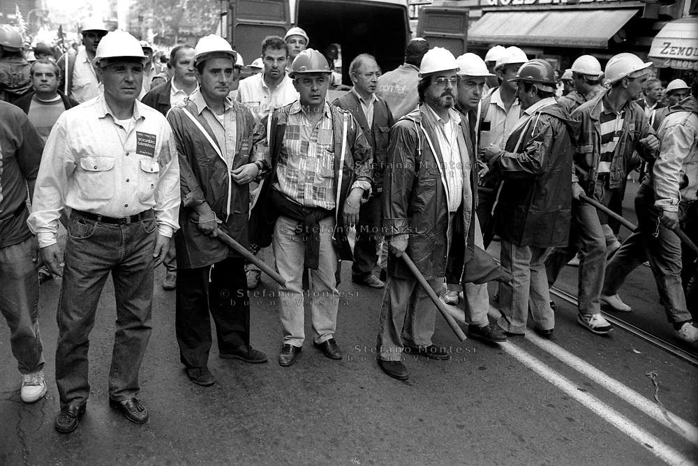 Roma 2 Ottobre 1992  .Il servizo d'ordine dei sindacati  Cgil-Cisl-Uil armato di bastoni attacca  in Via Cavour il corteo  del sindacato dei  Cobas durante la manifestazione per lo sciopero generale.Rome, October 2, 1992.The service order of the trade unions CGIL-CISL-UIL armed with sticks attacked in Via Cavour, the parade of union Cobas at the event for the general strike.