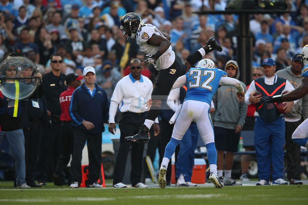 Baltimore Ravens running back Bernard Pierce (30) leaps over San Diego Chargers safety Eric Weddle (32) during an NFL game on Sunday, November 25, 2012 in San Diego, CA.  (Photo by Jed Jacobsohn)